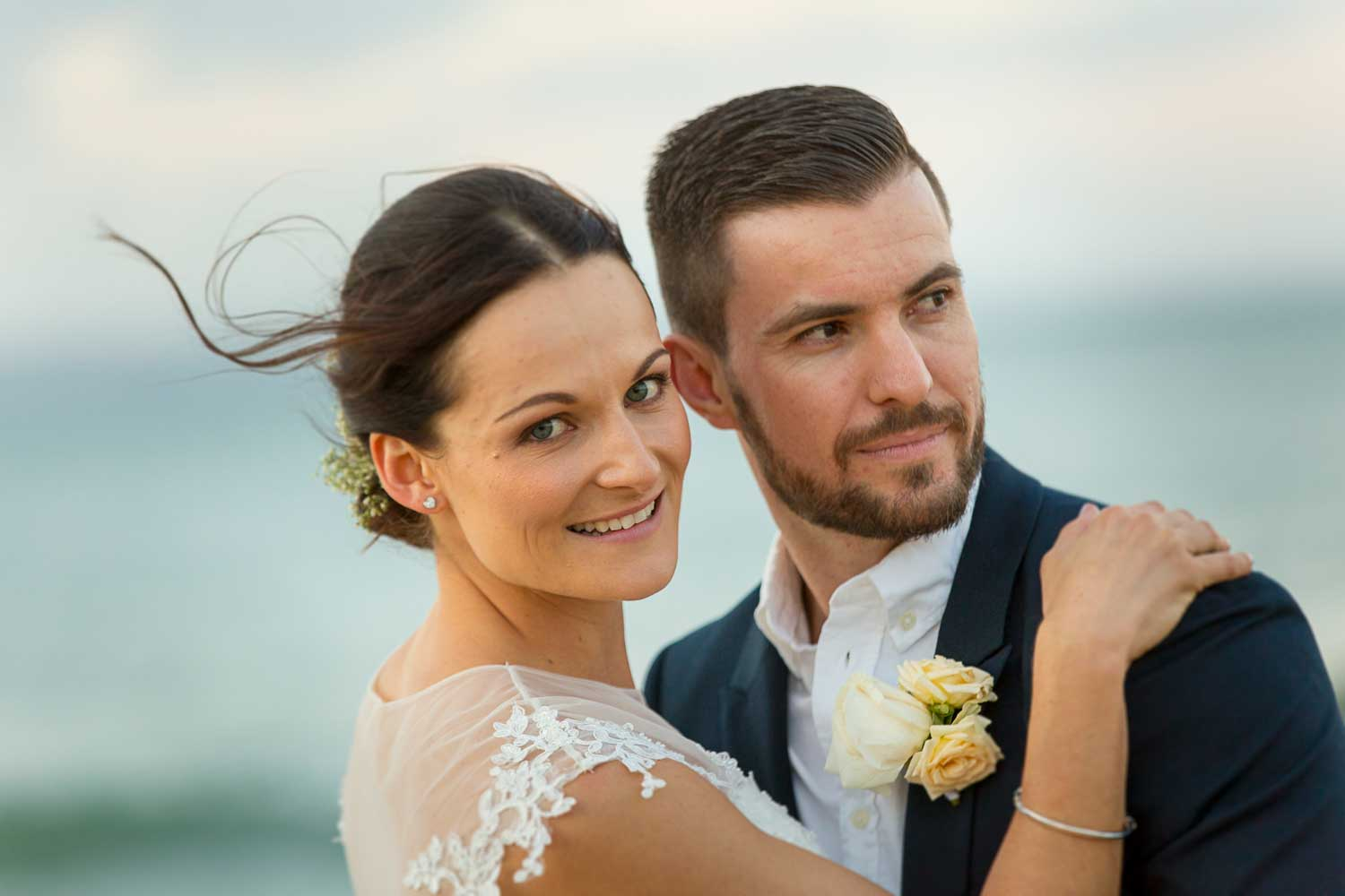 noosa weddings photographer captures a couple in love at sunset in little cove bay