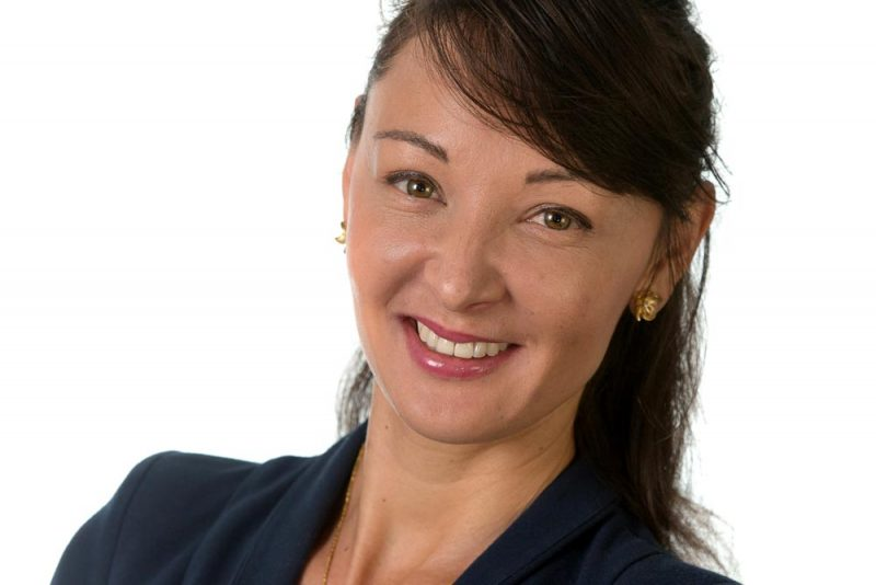 Brisbane commercial portrait photograph of business woman on a white background, staff photo for linkedin.