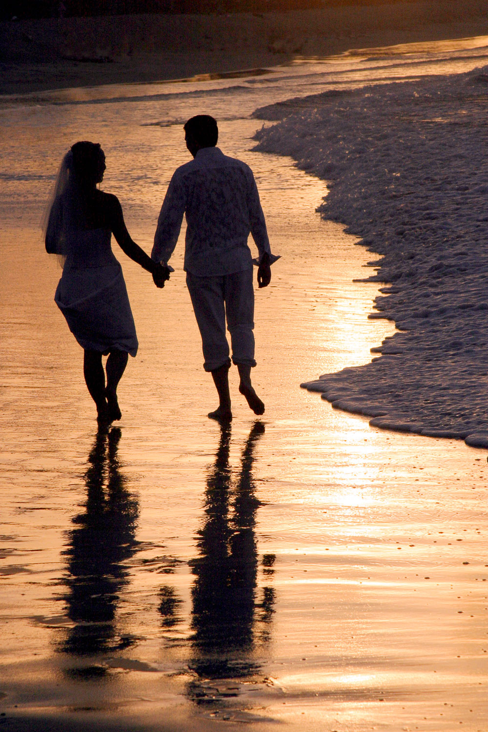wedding couple sunset beach walk