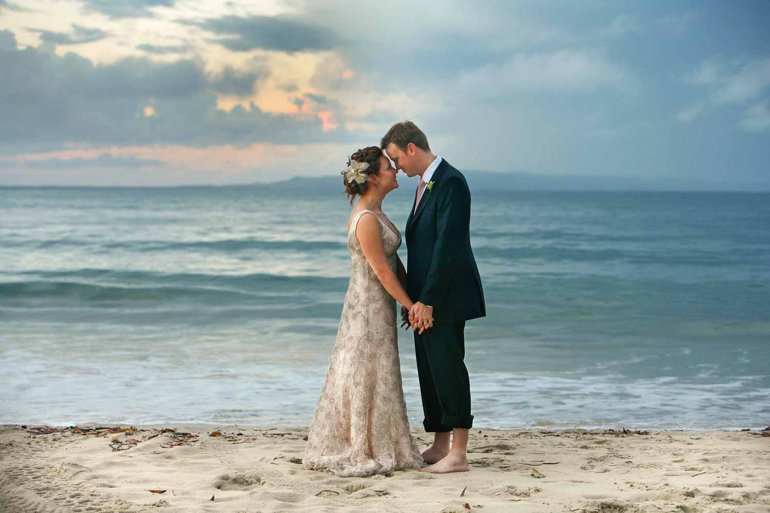 noosa wedding photographer with couple at sails with noosa first point as a background