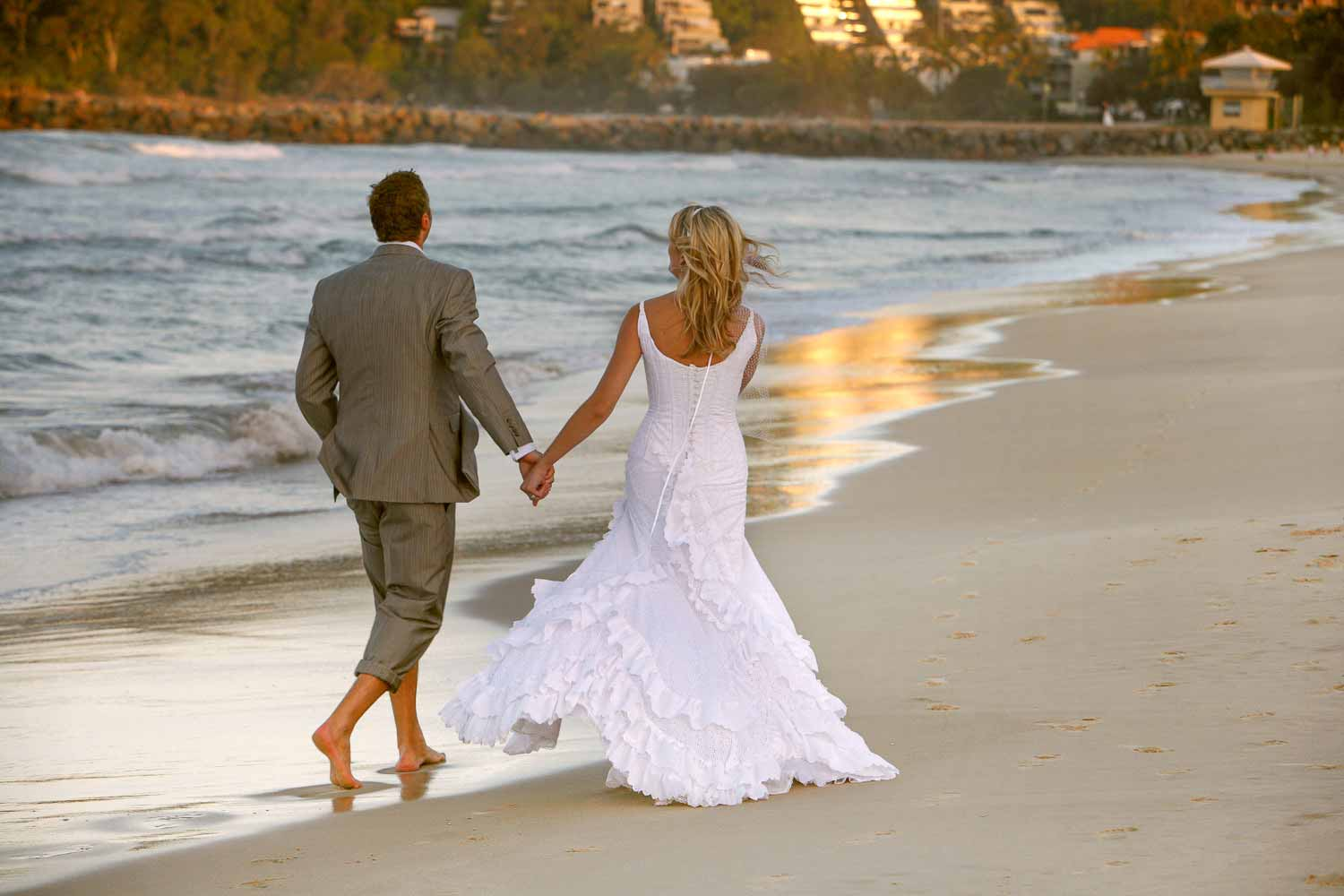 photographer wedding packages noosa hastings street beach with bride and groom on their wedding day