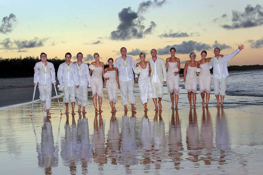 photographer wedding packages noosa main beach with bride and groom with their wedding party on their wedding day